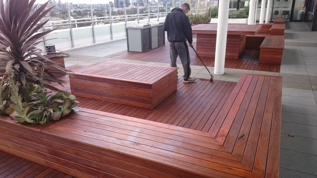 Large outdoor timber deck sealing